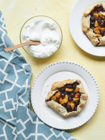 Mini Blueberry Peach Crostatas Recipe - an easy free form Italian pie with peaches and blueberries from my cookbook Kid Chef Bakes. SnappyGourmet.com