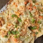 Buffalo Chicken Nachos after baked in oven on paper