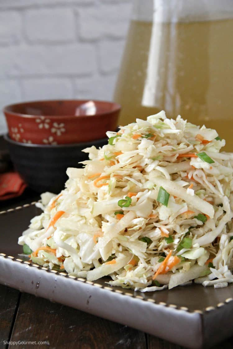 Asian Slaw on plate with drinks