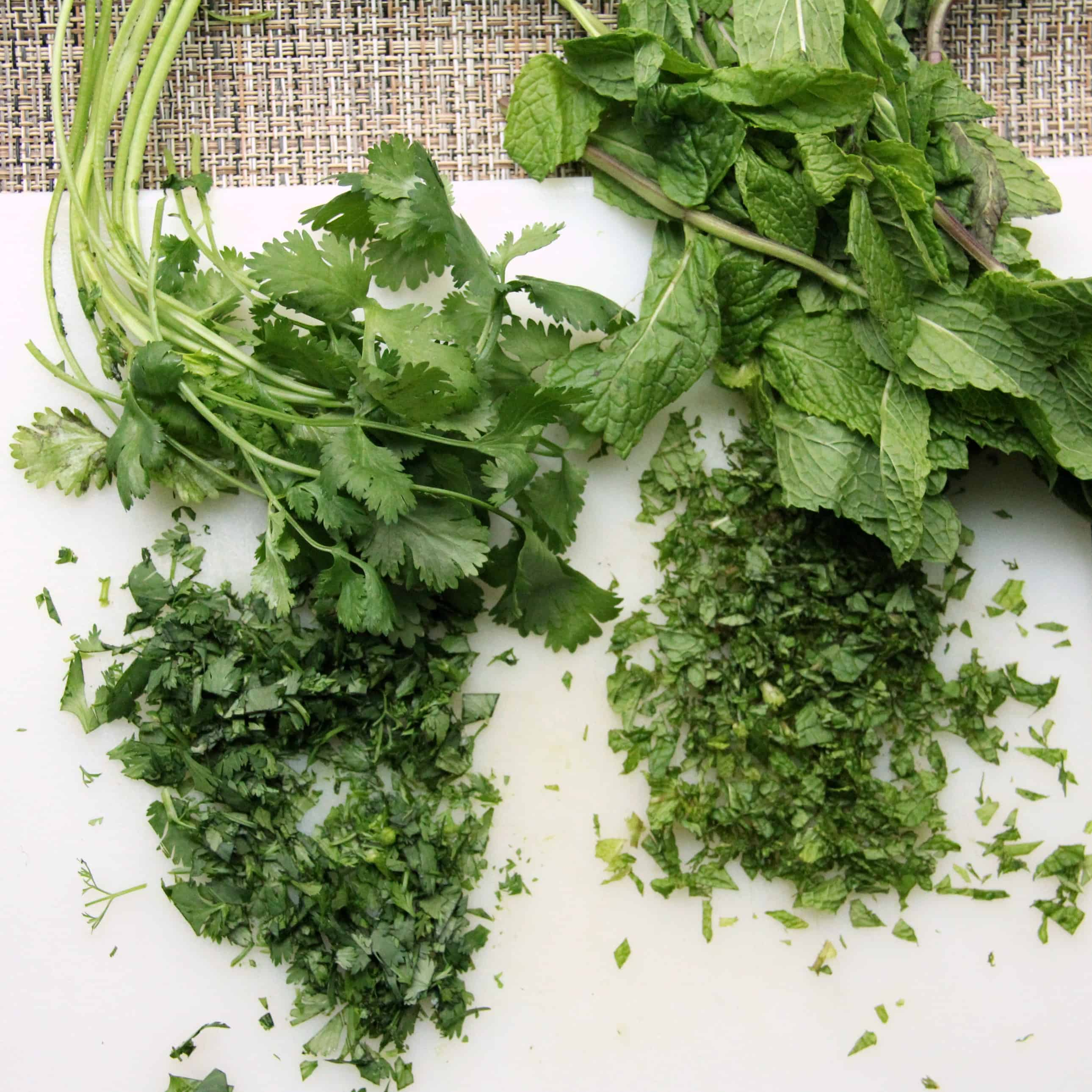 cilantro and mint on cutting board