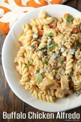 Buffalo Chicken Alfredo Pasta with carrots, celery, and blue cheese in bowl
