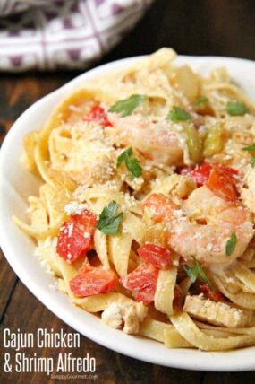 Cajun Chicken and Shrimp Alfredo Pasta with pepper and onions on plate