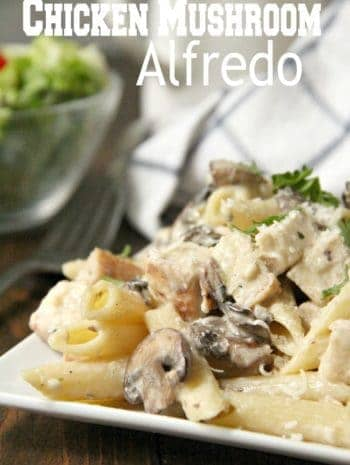 Chicken Mushroom Alfredo Pasta on plate with salad