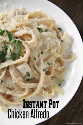 homemade Instant Pot Chicken Alfredo on white plate with parsley